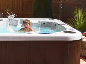 Kid playing in a hot tub